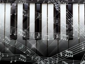 ピアノの鍵盤の上に五線が飛び交う絵